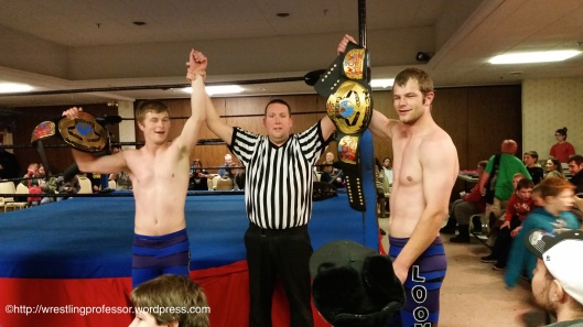 Referee Dube Confers Championship. Image © The Wrestling Professor