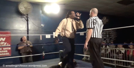 Butler Instructs Ref. Image: The Wrestling Professor